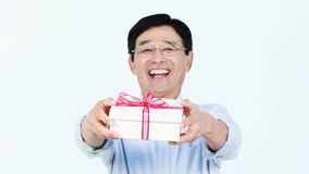 Middle-aged Asian man holding a present stock video footage