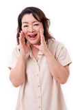Middle aged asian woman shouting Royalty Free Stock Photography