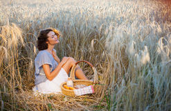 Middle aged beautiful smiling woman with basket outdoors Royalty Free Stock Photography