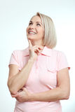 Middle-aged beautiful woman looking up thinking and dreaming  on white background. Middle aged beautiful woman looking up thinking and dreaming  on white Stock Image