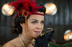 Middle aged beautiful women in Greate Gatsby style with glass of royalty free stock photography