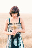Middle aged beauty woman in barley field Royalty Free Stock Image