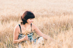 Middle aged beauty woman in barley field Stock Photography
