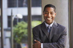 Middle aged black businessman looking at camera Stock Images