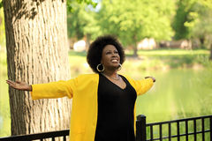 Middle Aged Black woman with arms outstretched Stock Photos