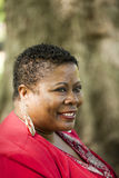 Middle-aged Black woman outdoor portrait red top Stock Photo
