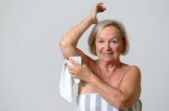 Middle Aged Blond Woman Shaving her Armpit Stock Photo