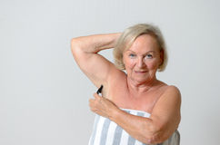Middle Aged Blond Woman Shaving her Armpit Stock Photos
