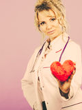 Middle aged blonde doctor enjoy her work. Royalty Free Stock Photo