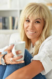Middle aged blonde woman Stock Images