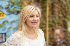 Middle-aged blonde woman with a serene expression Stock Photos
