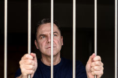 Middle aged blue eyed man incarcerated Stock Photos