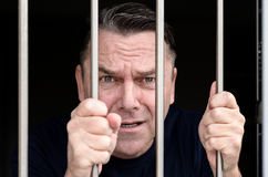 Middle aged blue eyed man incarcerated Royalty Free Stock Images
