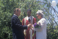 Middle aged bride and groom at an outdoor wedding ceremony, Ojai, CA Stock Photography