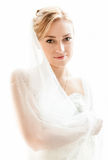 Middle aged bride in white dress with long veil Stock Photo