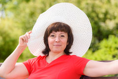 A middle-aged brunette white hat Royalty Free Stock Photography