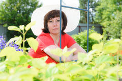 A middle-aged brunette white hat Stock Image