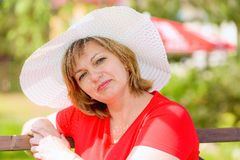 A middle-aged brunette white hat Royalty Free Stock Photo