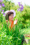 A middle-aged brunette white hat Royalty Free Stock Image