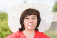 A middle-aged brunette white hat Royalty Free Stock Images