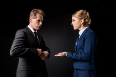 Middle aged business colleagues having conflict and quarreling Stock Photography