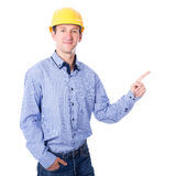 Middle aged business man or architect in yellow builder's helmet Stock Image