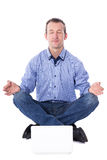 Middle aged business man sitting in yoga pose with laptop isolat Stock Image