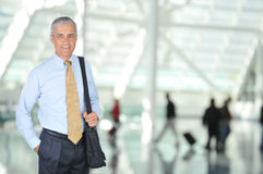Middle Aged Business Traveler in Airport Stock Image