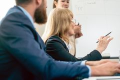 Middle-aged business woman presenting her opinion during a meeting Stock Photos