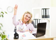 Middle-aged business woman throwing paper airplane Stock Images