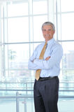 Middle aged Businessman arms crossed in Lobby Royalty Free Stock Photography