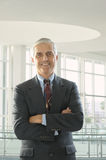Middle Aged Businessman Arms Folded Stock Photography