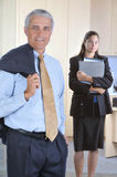 Middle aged Businessman with Assistant Stock Photography