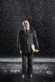 Middle Aged Businessman With Binder In Rain Royalty Free Stock Photo