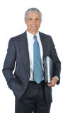 Middle aged businessman Carrying Laptop Stock Photo
