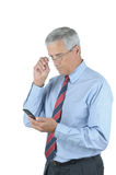 Middle Aged Businessman And Cell Phone Royalty Free Stock Photography