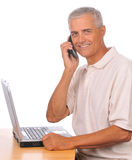 Middle aged Businessman with Cell Phone Computer Stock Images