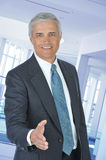 Middle aged Businessman With Extended Hand Royalty Free Stock Image