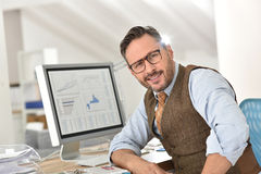 Middle-aged businessman with eyeglasses Royalty Free Stock Images