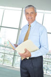 Middle aged Businessman with File Folder Stock Photos