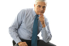 Middle aged Businessman with hand on chin Stock Image