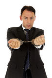 Middle aged businessman handcuffs Stock Photo