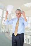 Middle Aged Businessman Hands Raised Royalty Free Stock Photos