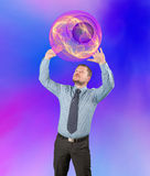 Middle-aged businessman holding abstract sphere up Royalty Free Stock Photography