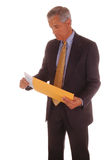 Middle Aged Businessman Holding Envelope Royalty Free Stock Photography