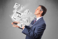 Middle aged businessman holding notebook Stock Image