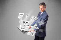 Middle aged businessman holding notebook and reading the explosi Stock Photos