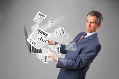 Middle aged businessman holding notebook and reading the explosi Royalty Free Stock Photo