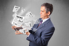 Middle aged businessman holding notebook and reading the explosi Royalty Free Stock Photos