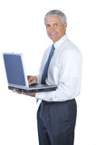 Middle Aged Businessman Holding Open Laptop Royalty Free Stock Photography